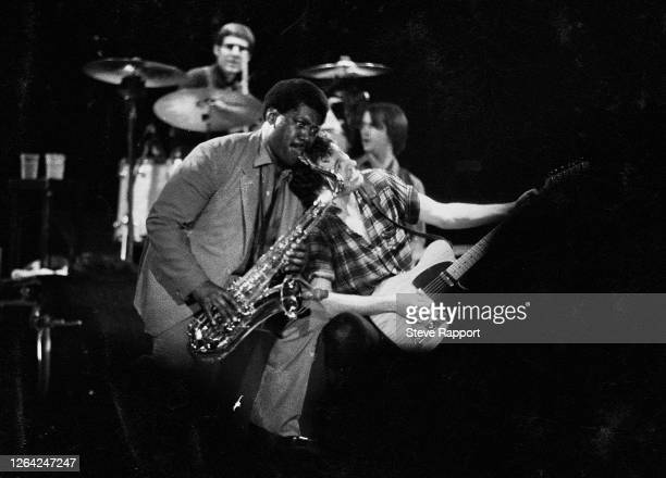 American Rock musicians Clarence Clemons and Bruce Springsteen perform onstage, during 'The River' tour, Wembley Arena, London, 6/1/1981.