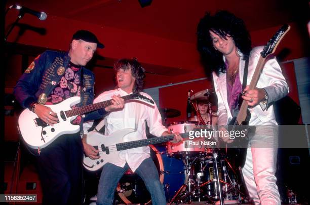 American Rock musicians from left Rick Nielsen of the group Cheap Trick Toby Myers from John Mellencamp's band and Steve Stevens perform onstage at...