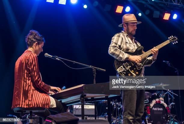 American Rock musicians Jesse Paris Smith on keyboards and Jackson Smith on guitar perform with their mother Patti Smith's band during a tribute to...