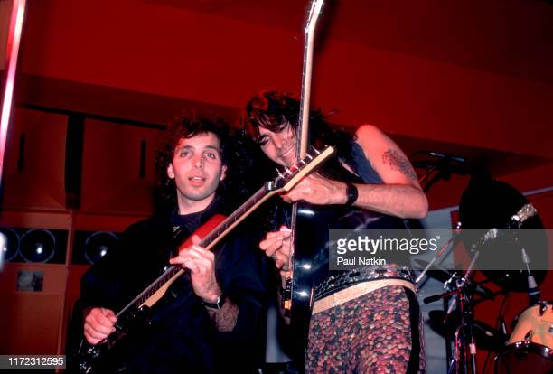 American Rock musicians Joe Satriani and Steve Vai play guitars as they perform onstage the Limelight, Chicago, Illinois, June 27, 1987.