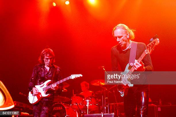American rock musicians Steve Vai and Billy Sheehan, Chicago, Illinois, October 24, 2003. Behind them is drummer Jeremy Colson.