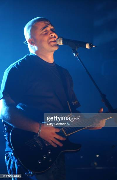 American Rock & Nu Metal musician Aaron Lewis, of the group Staind, plays guitar as he performs onstage at the Hammerstein Ballroom, New York, New...
