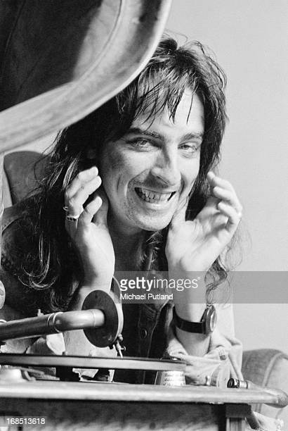 American rock singer Alice Cooper listening to a vintage phonograph London March 1974