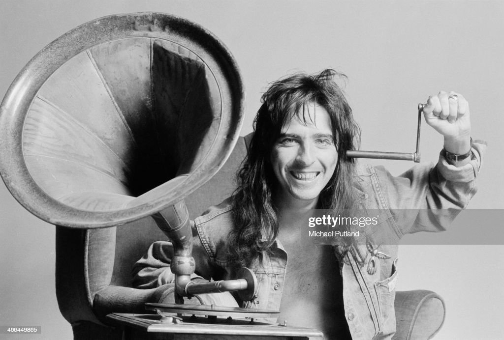 American rock singer Alice Cooper listening to a vintage phonograph, London, March 1974.