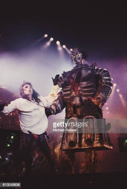 American rock singer Alice Cooper performing on stage in the late 1980's