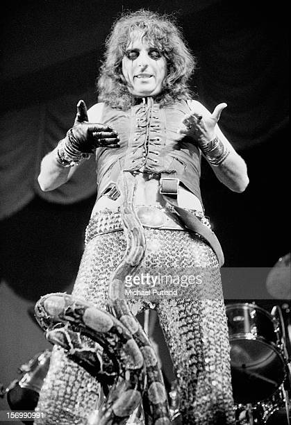 American rock singer Alice Cooper performs with a large snake in Glasgow 10th November 1972