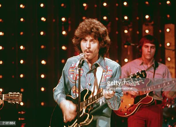 American rock singer and musician Johnny Rivers performing on the television show 'Midnight Special' circa 1975