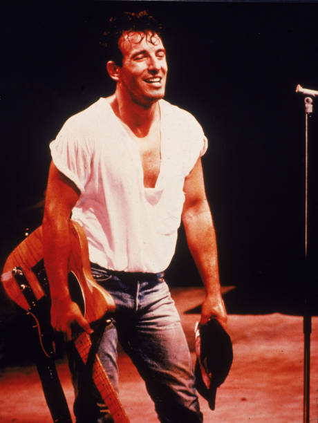 Bruce Springsteen Holds Guitar On Stage