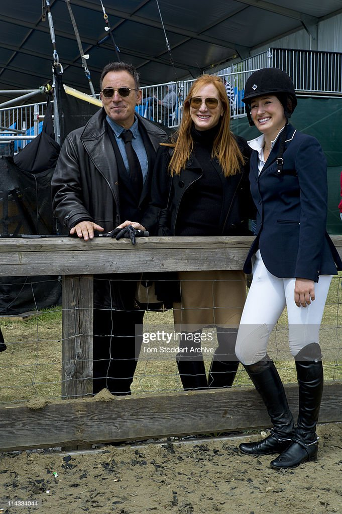 American rock singer Bruce Springsteen and his wife Patti Scialfa, photographed with their daughter Jessica Springsteen after she won her jumping category while competing at the Royal Windsor Horse Show, Berkshire, 14th May 2011.