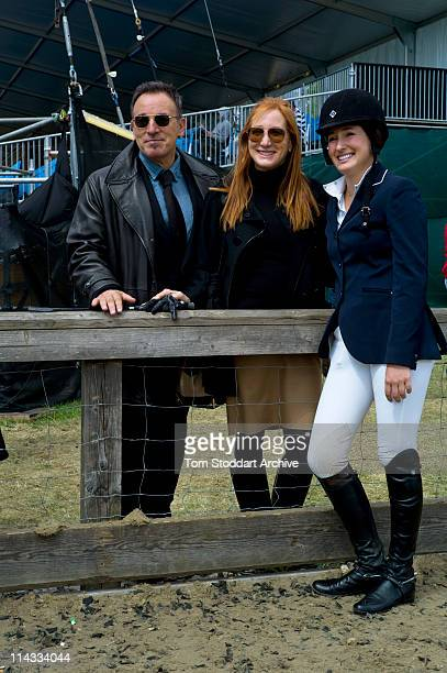 American rock singer Bruce Springsteen and his wife Patti Scialfa, photographed with their daughter Jessica Springsteen after she won her jumping...