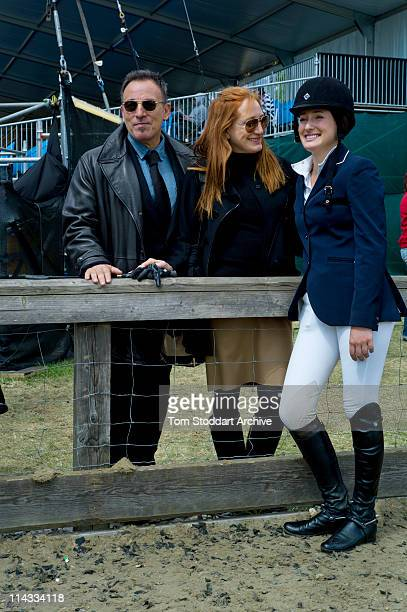 American rock singer Bruce Springsteen and his wife Patti Scialfa photographed with their daughter Jessica Springsteen after she won her jumping...