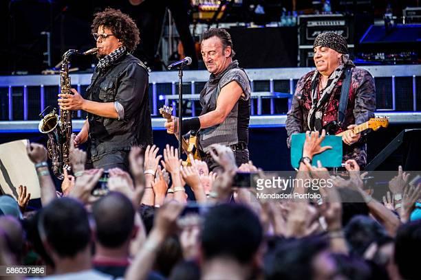 American rock singer Bruce Springsteen in concert at San Siro Stadium Beside him American guitarist Little Steven and saxophonist Jake Clemons The...