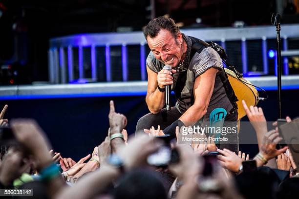American rock singer Bruce Springsteen in concert at San Siro Stadium The excited audience applauding him from under the stage The River Tour Milan...