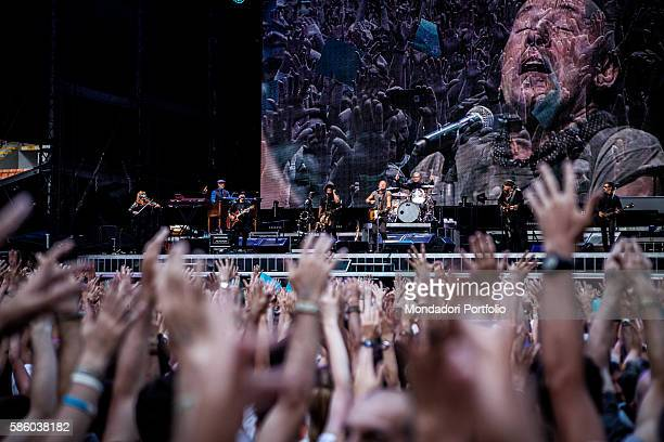American rock singer Bruce Springsteen in concert at San Siro Stadium The Boss' face appearing on the monitor behind the musicians Under the stage...