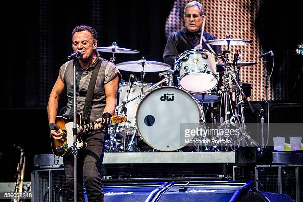 American rock singer Bruce Springsteen in concert at San Siro Stadium Behind him American drummer and member of the E Street Band Max Weinberg The...