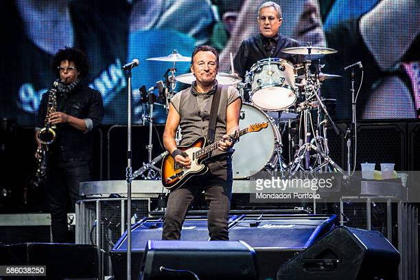 American rock singer Bruce Springsteen in concert at San Siro Stadium Behind him American drummer Max Weinberg and saxophonist Jake Clemons The River...