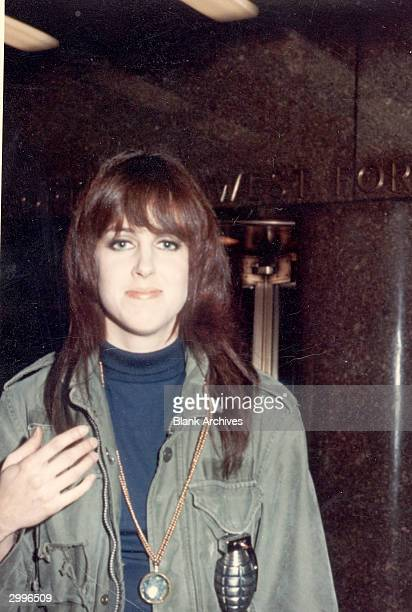 American rock singer Grace Slick the lead vocalist of the band Jefferson Airplane wears a military jacket with a hand grenade attached after...
