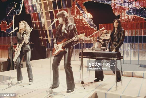 American rock singer Suzi Quatro performing with her group all dressed in leather jackets and trousers on the Christmas Day edition of the BBC TV...