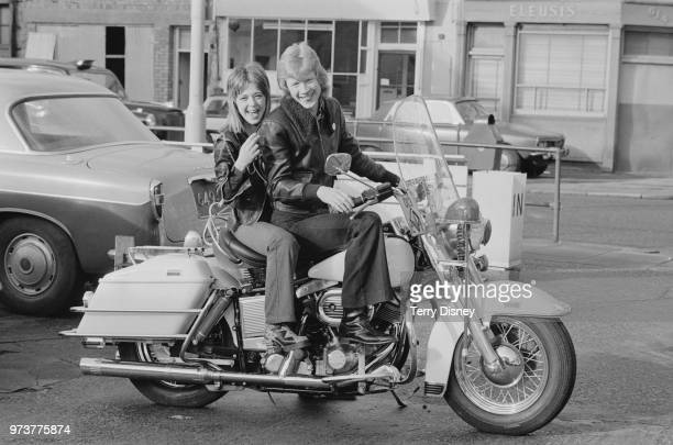 American rock singersongwriter multiinstrumentalist and actress Suzi Quatro sitting on a HarleyDavidson Electra Glide motorcycle with Canadianborn...