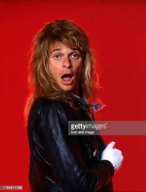 """American rock vocalist and former lead singer of Van Halen, David Lee Roth, poses for a portrait backstage at Cobo Arena during his """"Eat 'Em and..."""