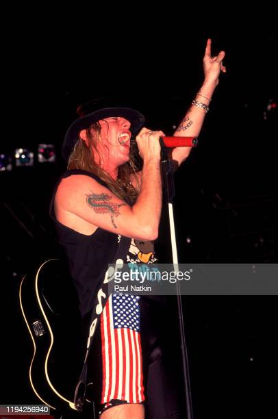 American Rock vocalist Jani Lane of the group Warrant performs onstage at the Rosemont Horizon Rosemont Illinois November 5 1989