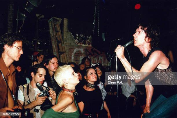 American rock vocalist Stiv Bators of the group the Dead Boys performs onstage at the CBGBs nightclub New York New York 1978 Among those visible in...