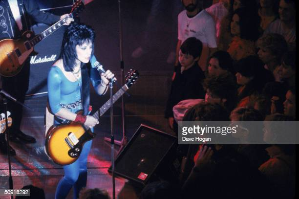 American rocker Joan Jett performs for a youthful audience 1984