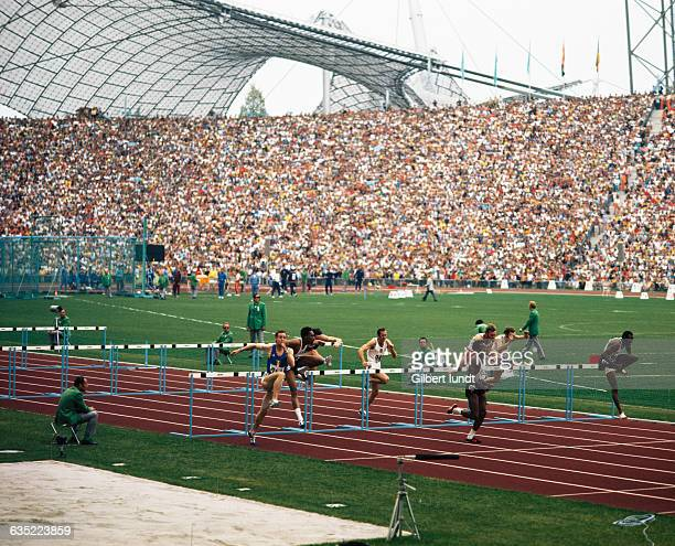 American Rod Milburn leads the men's 110-meter final of the 1972 summer Olympics. He won the Gold medal ahead of Guy Drut from France .