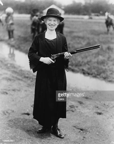 American rodeo star and sharpshooter Phoebe Mozee better known as Annie Oakley holding a gun given to her by Buffalo Bill 1922