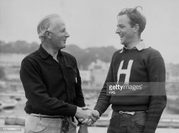American sailor Paul Smart and his son American sailor Hilary Smart shake hands after winning the Star class sailing event at the 1948 Summer...