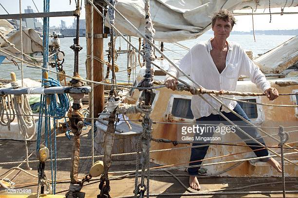 American sailor Reid Stowe pauses on the deck of his weathered boat the day after returning from his 1152 days at sea at the helm of his handbuilt...