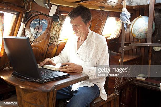 American sailor Reid Stowe's at the seat he used to keep his journal and chart his route during 1152 days at sea at the helm of his handbuilt...