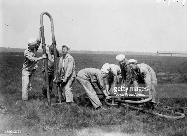 American sailors at work at Mineola, Long Island, New York, where the British airship R.34 landed on 2nd July 1919, having completed the first east...
