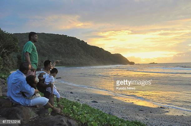 POLOA American Samoa Villagers look at the sunset in the village of Poloa the westernmost part of American Samoa on Jan 2 2012 It is the last sunset...
