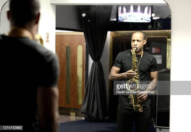 American saxophone player Walter Blanding warms up backstage at The Barbican in London on 13th July 2012