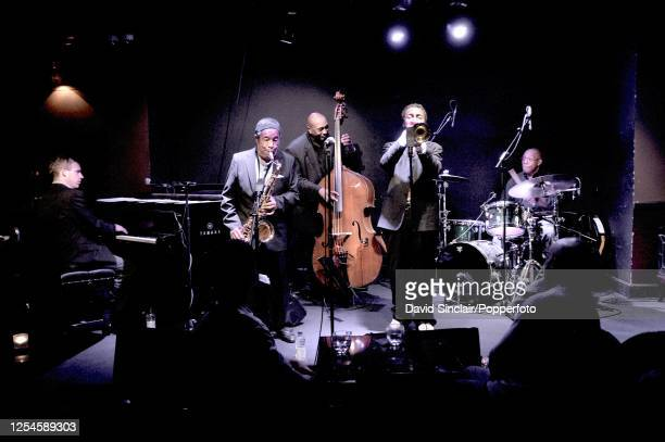 American saxophonist Johnny Griffin performs live on stage with trumpeter Roy Hargrove , pianist James Pearson, double bassist Reggie Johnson and...