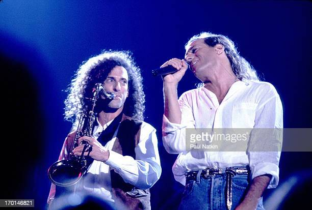 American saxophonist Kenny G performs with singer Michael Bolton on stage as part of the latter's television special 'This is Michael Bolton '...