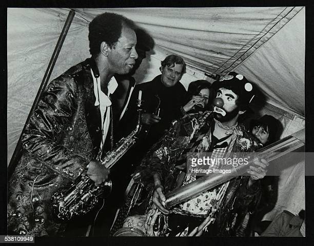 American saxophonist Ornette Coleman meets a clown Bracknell Jazz Festival Berkshire 1978 Piano player and trombonist Eddie Harvey is in the...