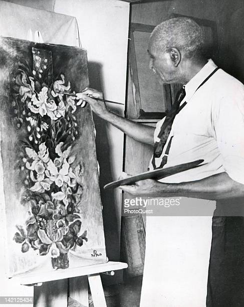 American scientist and educator Dr George Washington Carver works on one of his last paintings entitled 'The Yucca' early to mid twentieth century