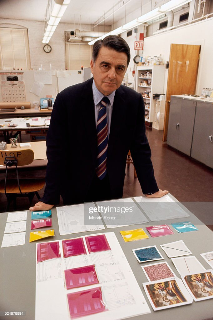 Inventor, physicist, and founder of the Polaroid Corporation Edwin H. Land stands with polaroids and research results in a Polaroid lab.