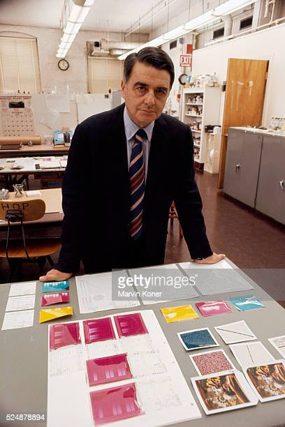 Inventor physicist and founder of the Polaroid Corporation Edwin H Land stands with polaroids and research results in a Polaroid lab
