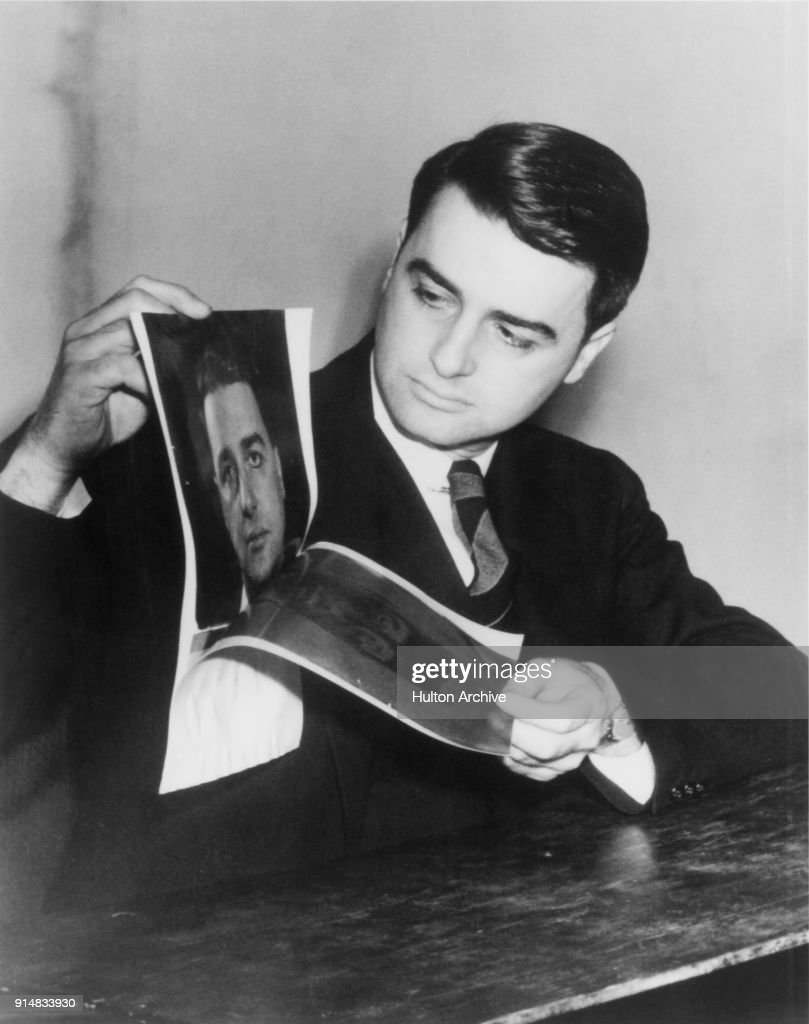 American scientist and inventor Edwin Herbert Land (1909 - 1991) demonstrates his instant camera or Land Camera, manufactured by Polaroid, circa 1947.