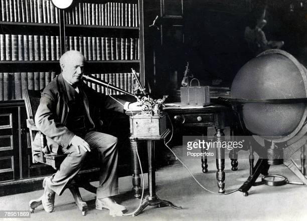 American Scientist and Inventor Thomas Edison photographed in his study with one of his phonographs