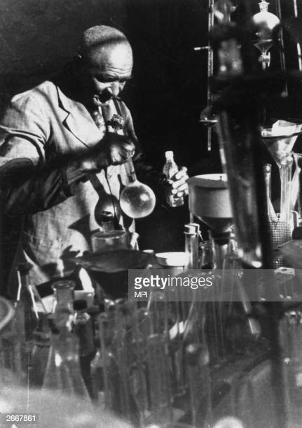 American scientist George Washington Carver the son of a slave from Missouri working at the Tuskegee Faculty in Alabama