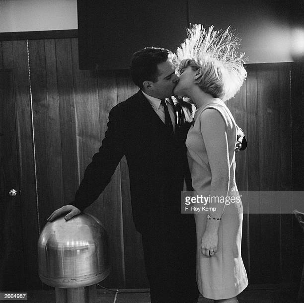 American scientist James Stuckey and volunteer Judy Creeden demonstrate the human body's ability to function as a conductor of electricity during a...