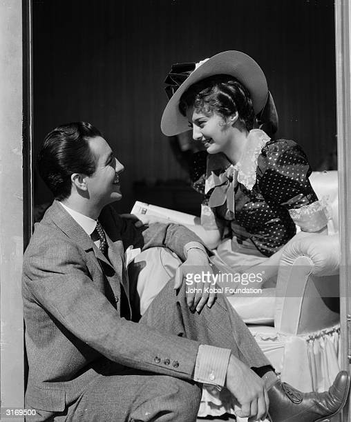 American screen star Barbara Stanwyck with her husband actor Robert Taylor between filming 'This is My Affair'