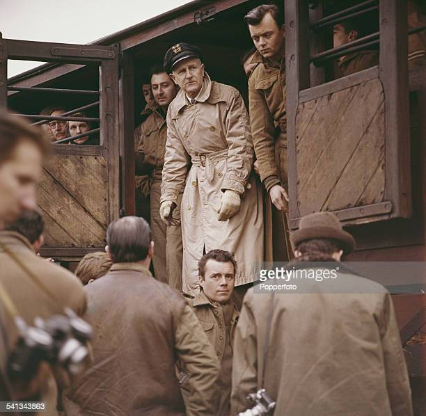 American screenwriter and director Andrew L Stone pictured top centre with actor Dirk Bogarde on location during filming of the feature film 'The...