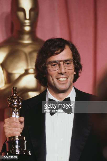 American screenwriter director producer and composer Joseph Brooks with the Academy Award presented to him for Best Original Song for 'You Light Up...