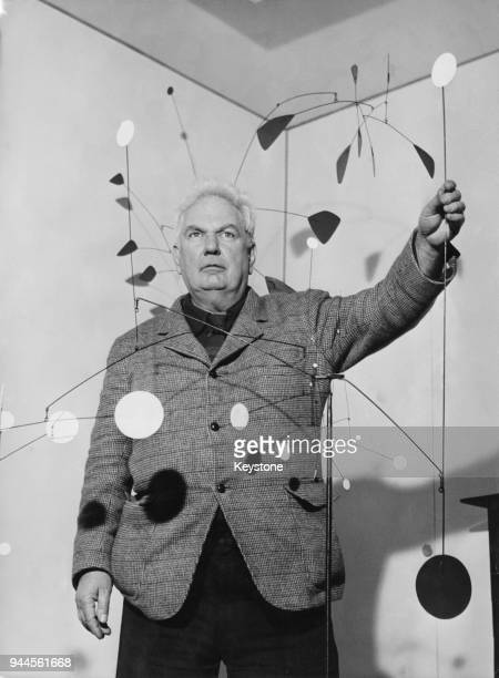 American sculptor Alexander Calder at the opening of an exhibition of his mobiles at the Galleria Dell'Obelisco in Rome Italy 14th March 1956