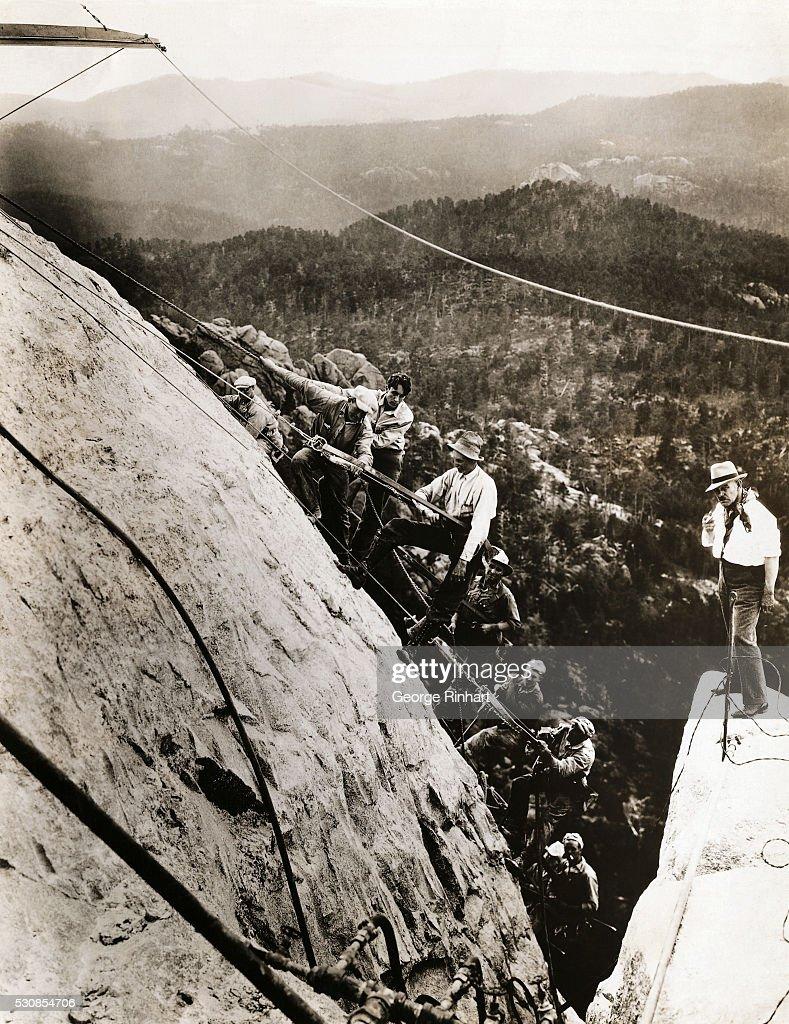 Gutzon Borglum and Sculptors at Mount Rushmore : News Photo